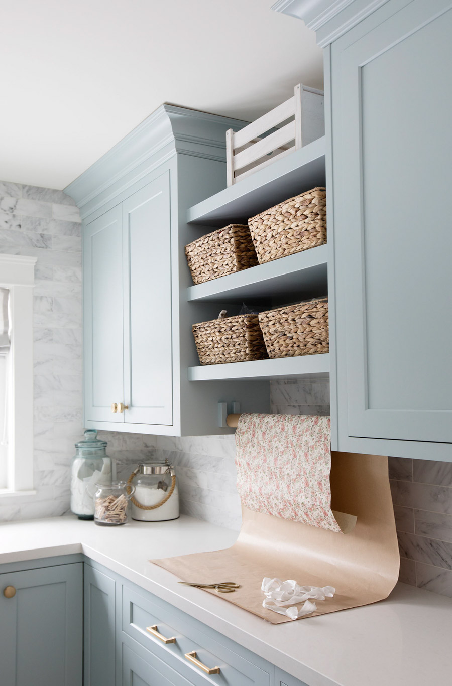A GORGEOUS blue paint color - from Jillian Harris' laundry room!