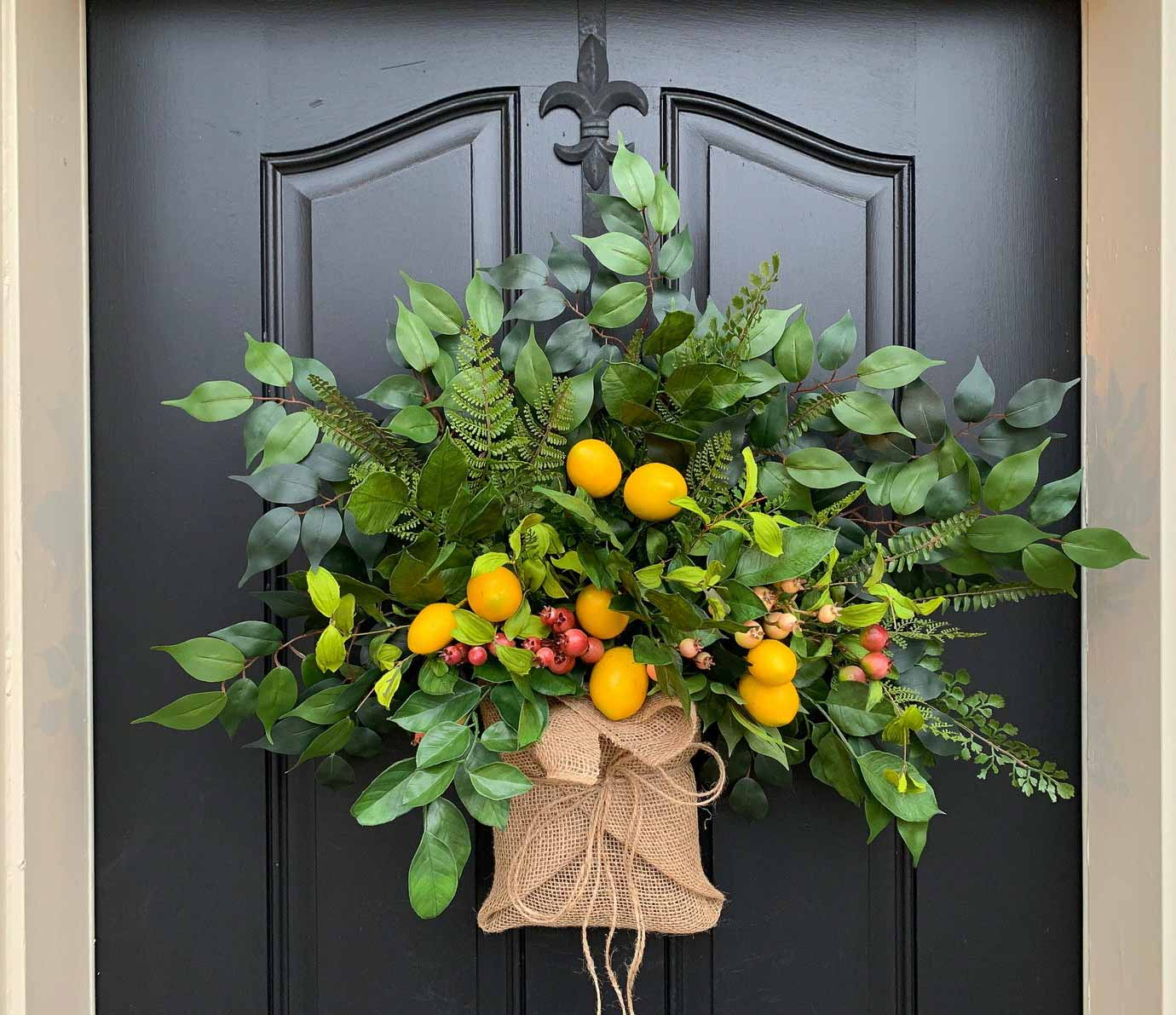 "Love this spring ""wreath"" that looks like a colorful burlap wrapped bouquet!"