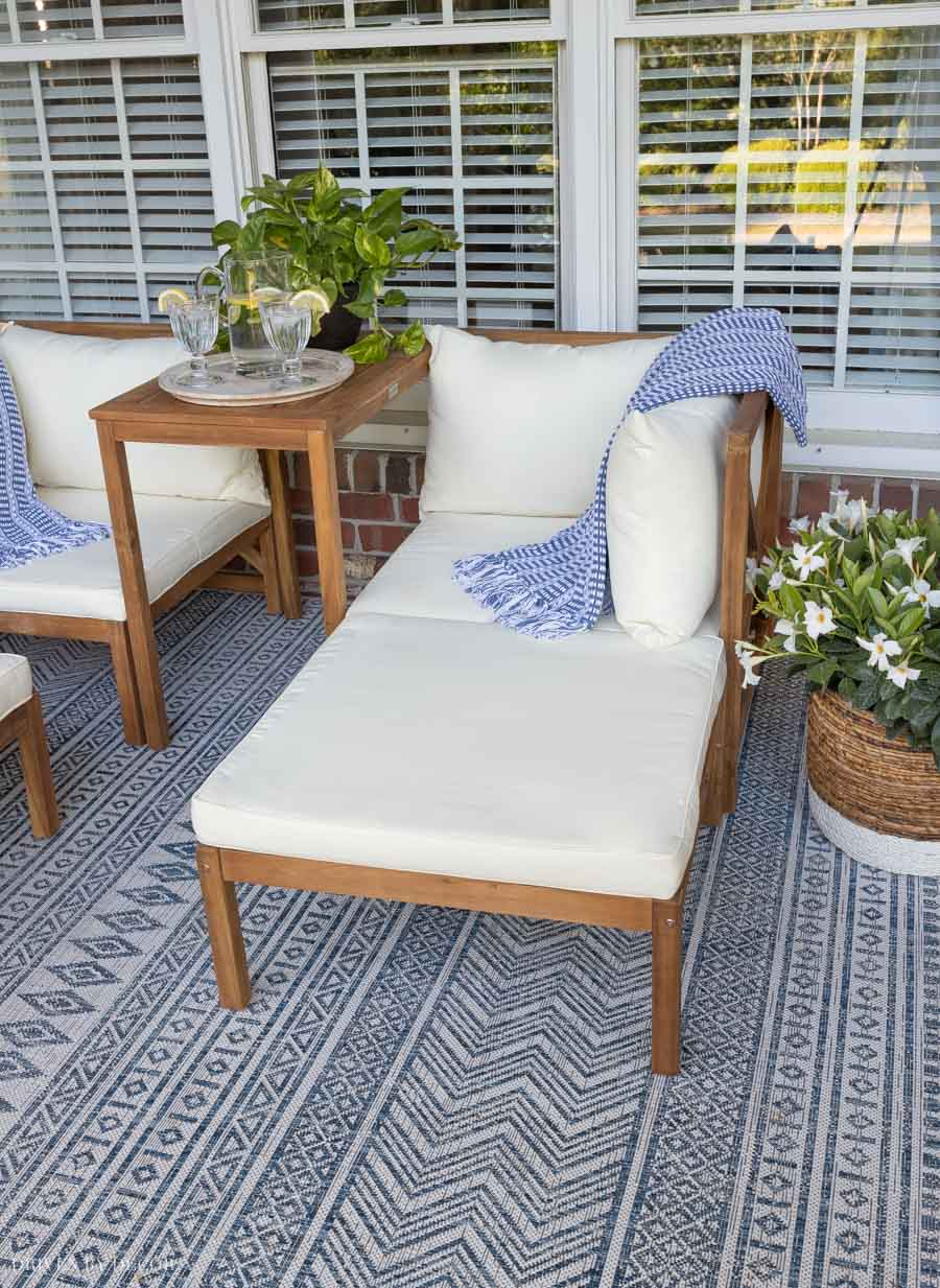 Love this furniture on her back porch - you can push the ottomans in to use them as loungers!