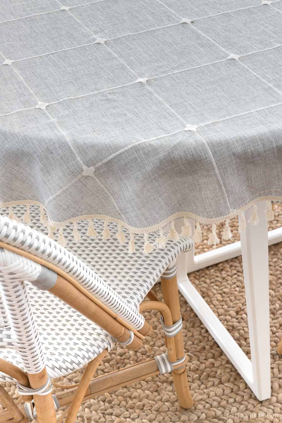 A super cute tasseled tablecloth on this breakfast nook table!