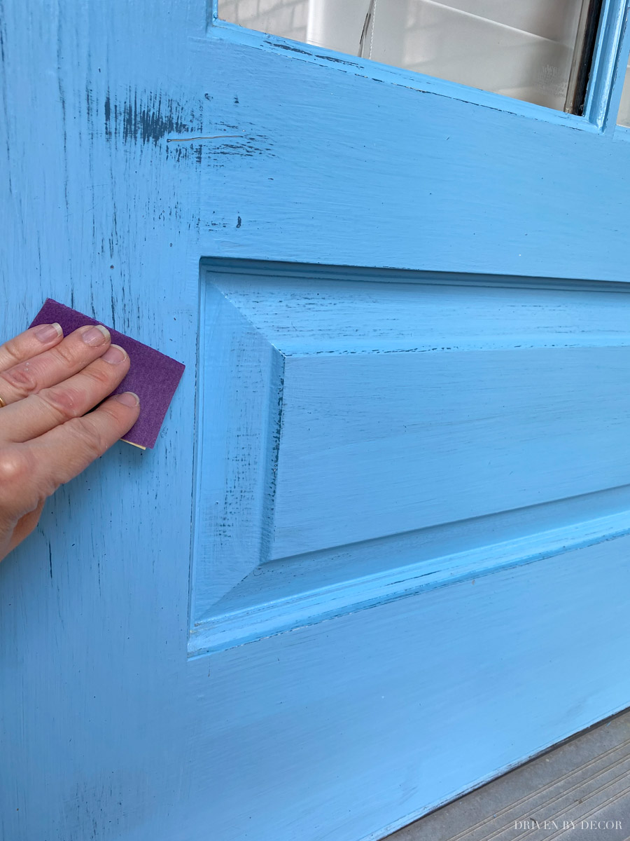 Prep your front door for paint by lightly sanding it