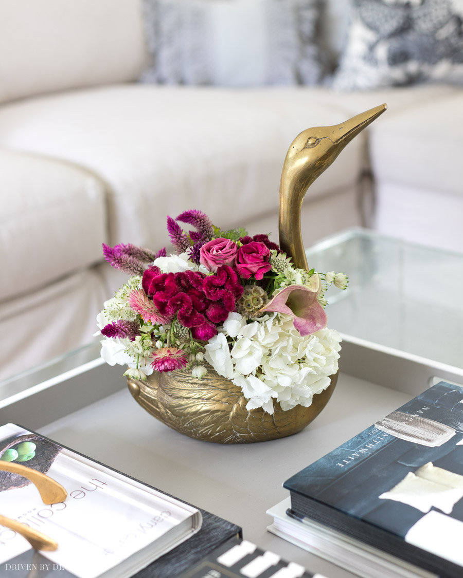 Loving this brass swan planter filled with flowers!