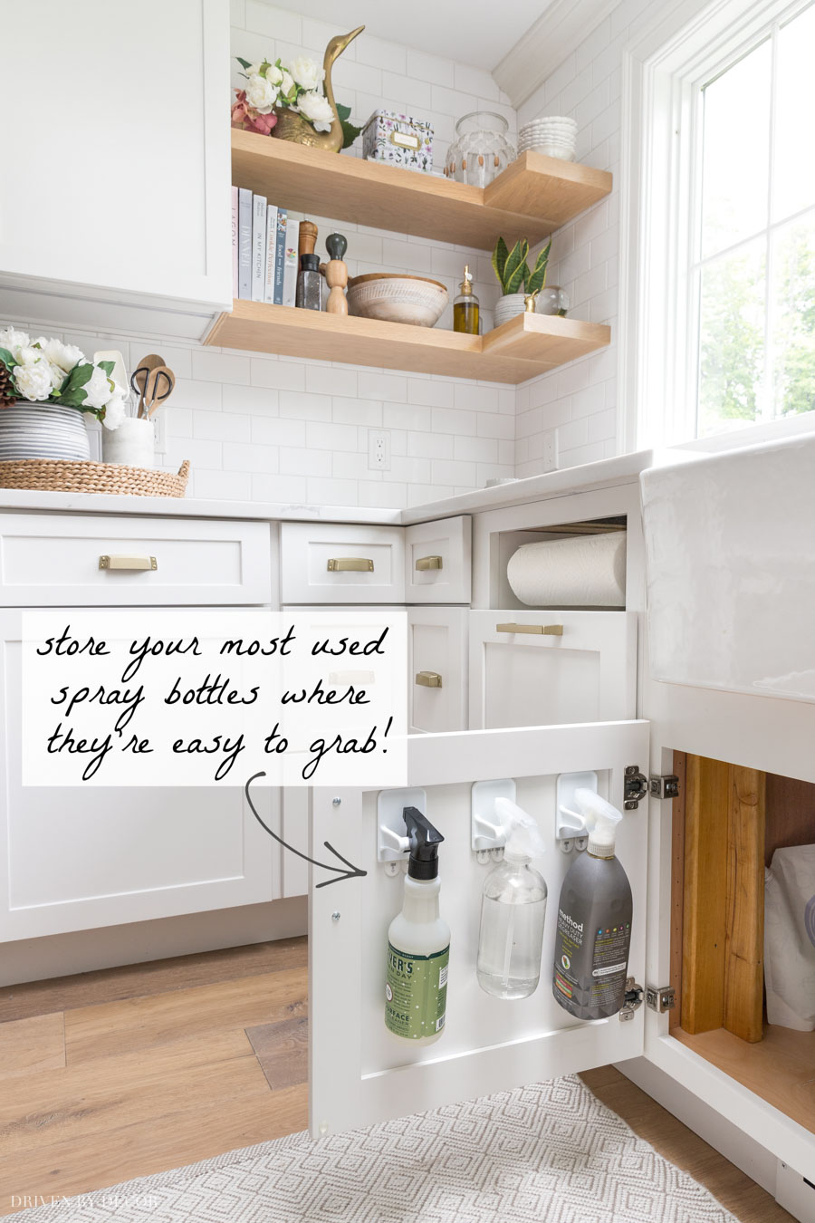 LOVE this idea for keeping spray bottles off the counter but easy to grab!