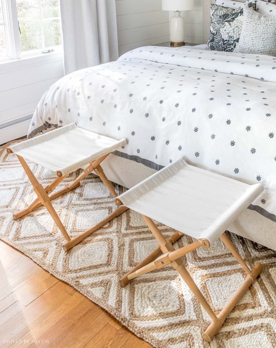 Instead of a bench at the end of the bed, I love the look of two stools like this!