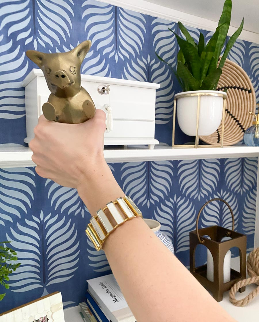The cutest accessories for shelves - love the brass pig bookend!