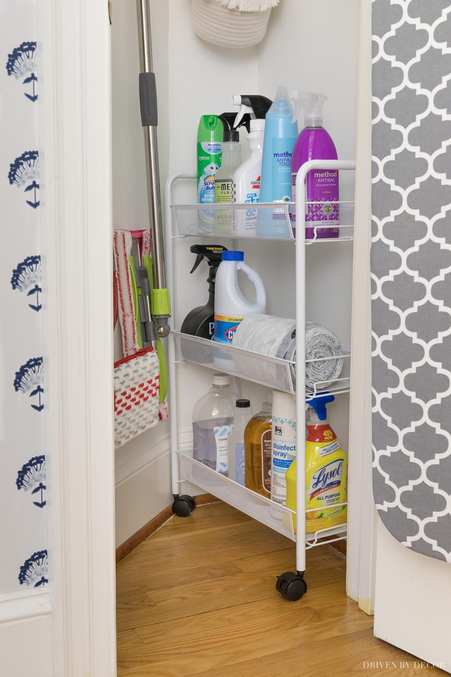 Using a rolling cart for storage in this utility closet was a game changer!