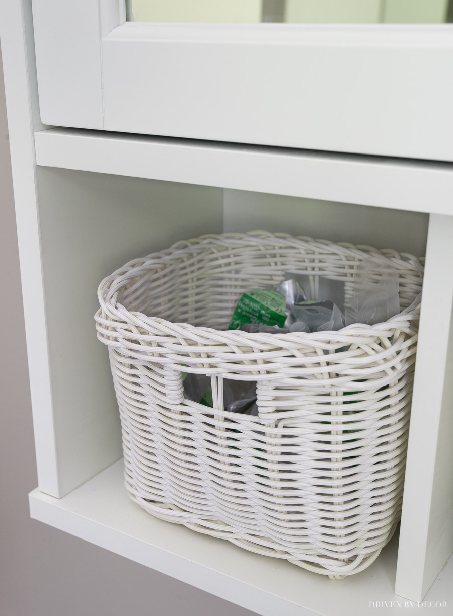 Love how this bathroom cabinet has basket storage bins as part of it!