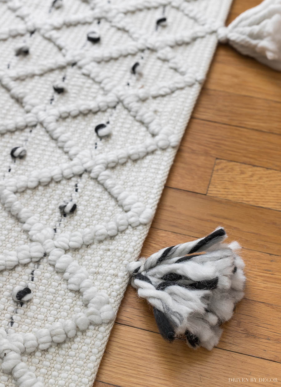 LOVE the tassels on this cute rug in her home office!!