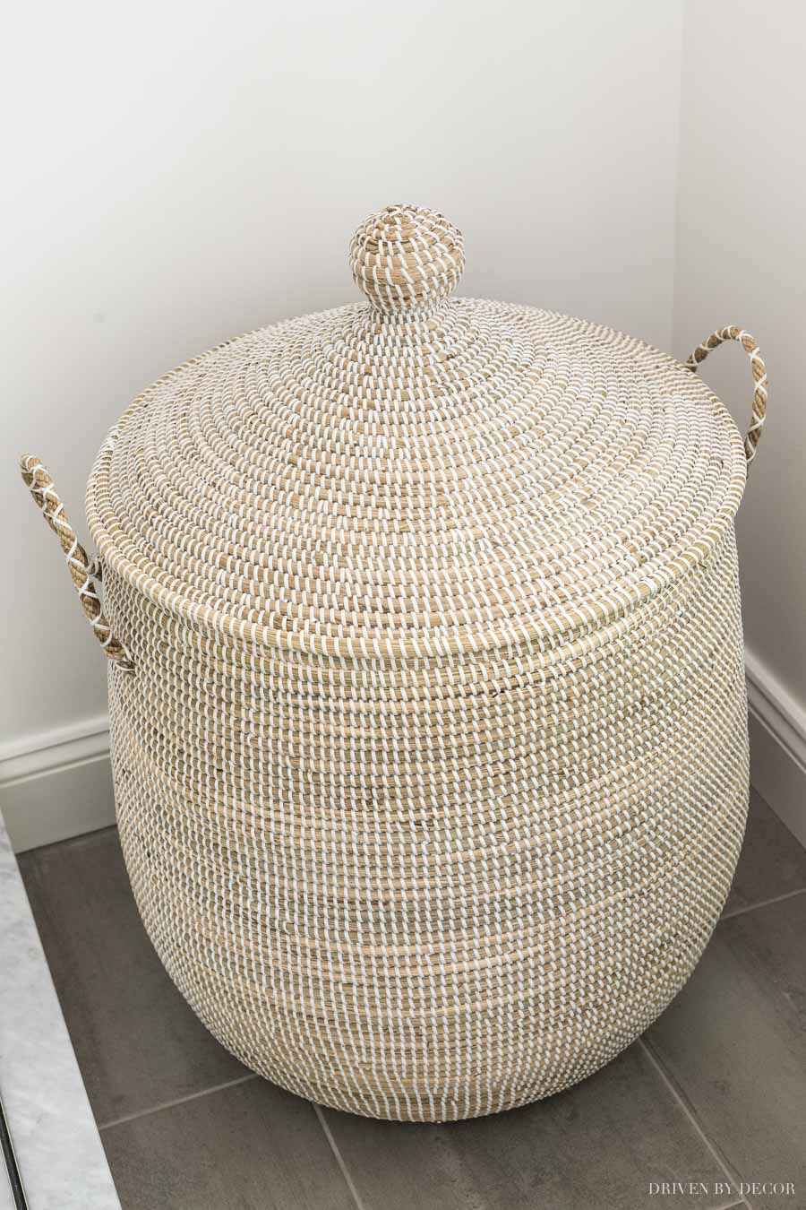 The prettiest basket to use as a hamper! One of the beautiful bathroom decor ideas in this post!