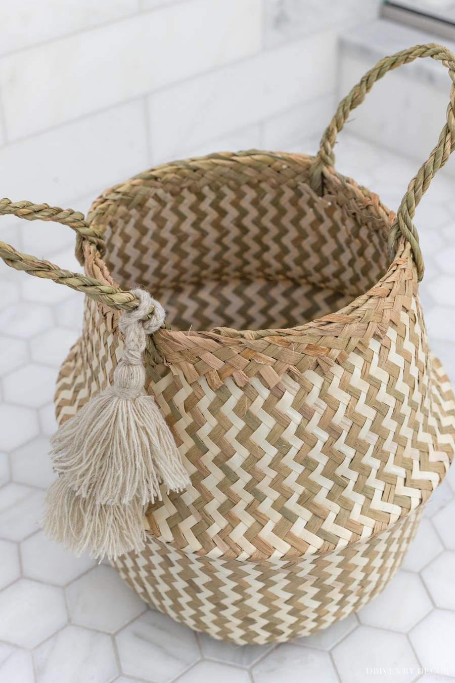 This darling woven basket with tassels is the cutest bathroom decor storage option!