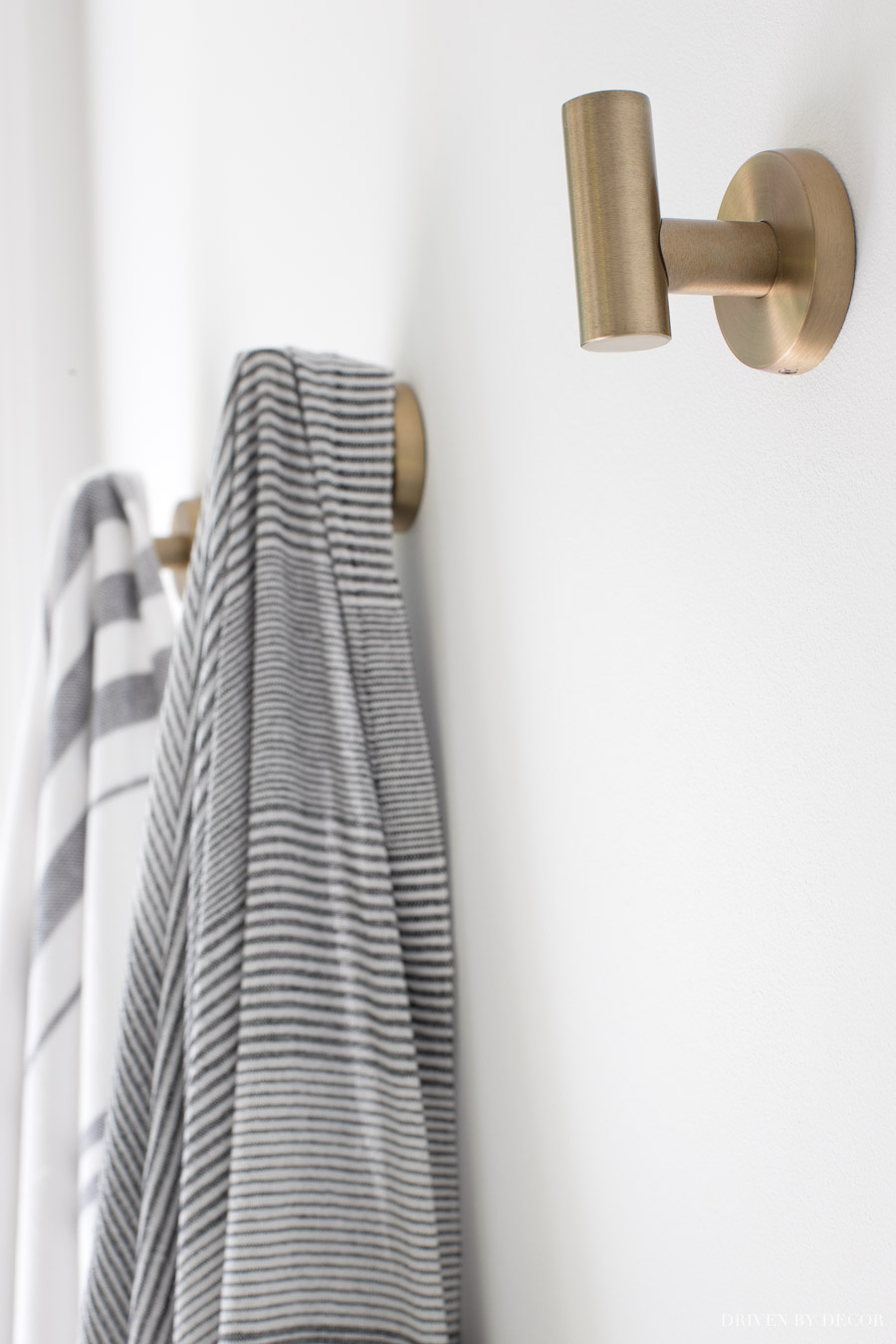 Such pretty brass towel hooks in this master bathroom!