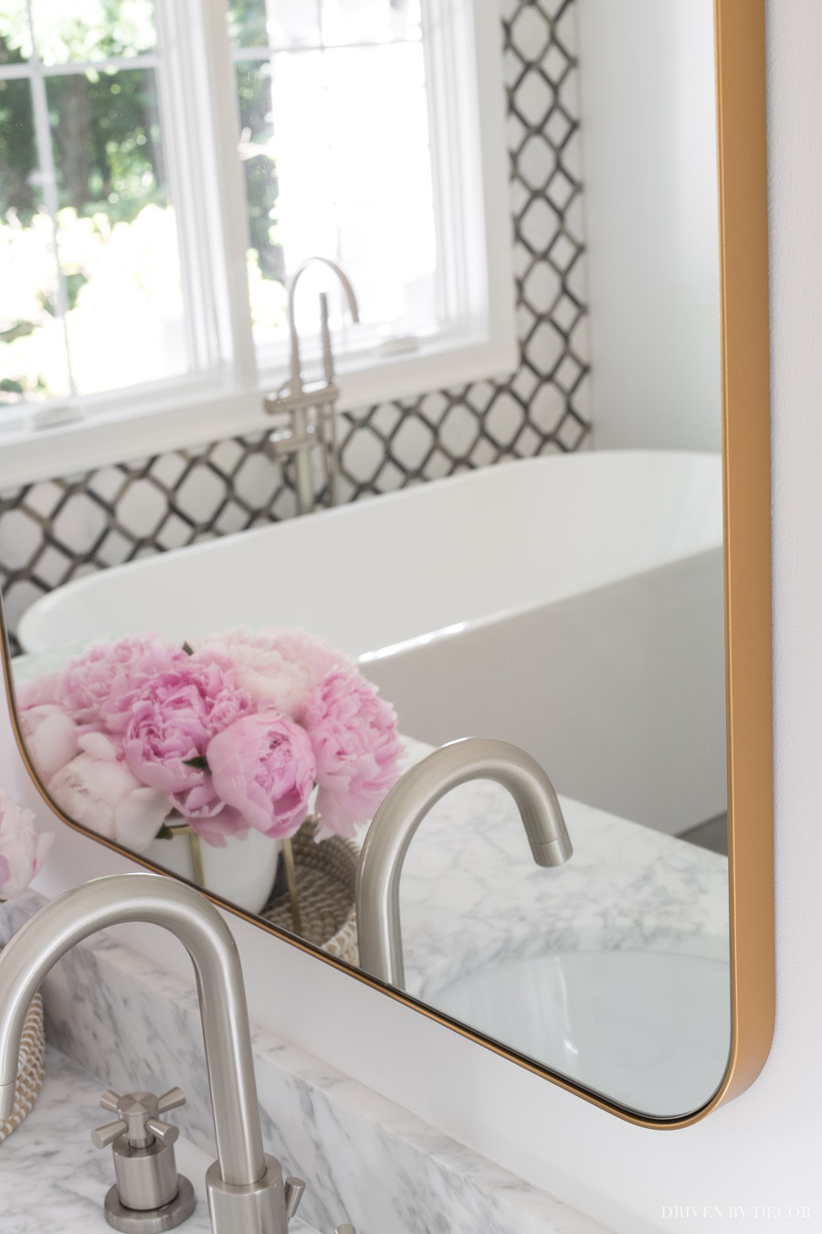 Love the design of this large bathroom mirror with a thin gold edge