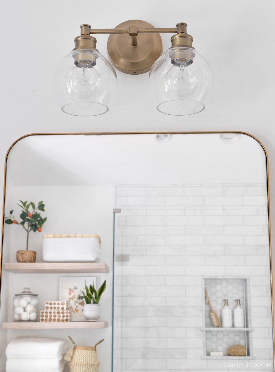 Love the globe lights on this gorgeous brass 2-light vanity light!