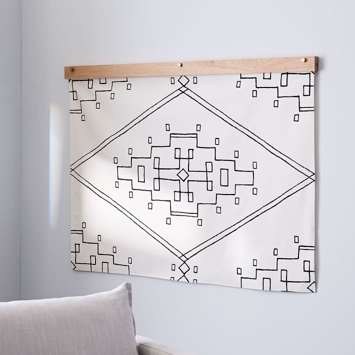 Love the the idea of a tapestry like this for living room wall decor!
