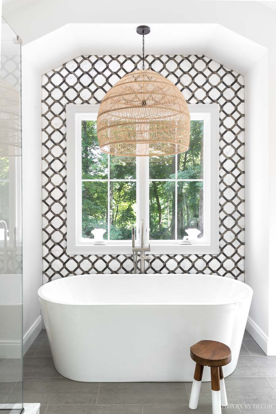 The freestanding tub in our master bathroom with a stunning statement-making tile wall!