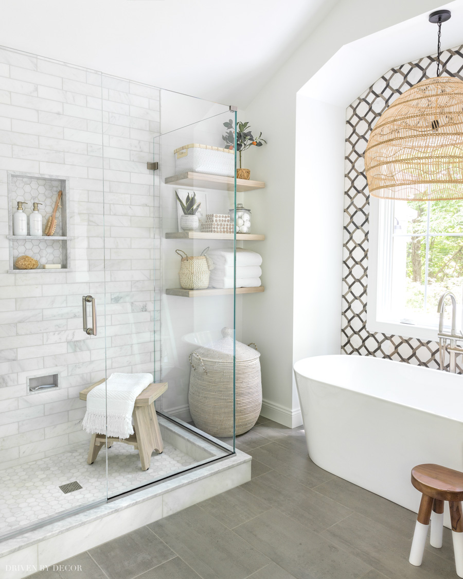 Our master bathroom reveal! Details on shower, shelves, tiled wall and more are on the blog!