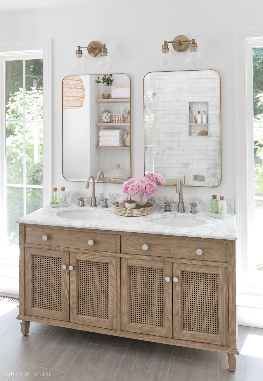 What a gorgeous wood double vanity! Love the caned doors!
