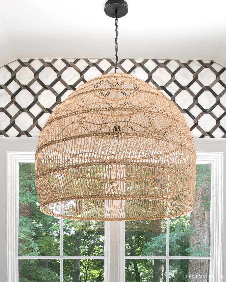 LOVE this large rattan pendant over the bathtub in her master bathroom!