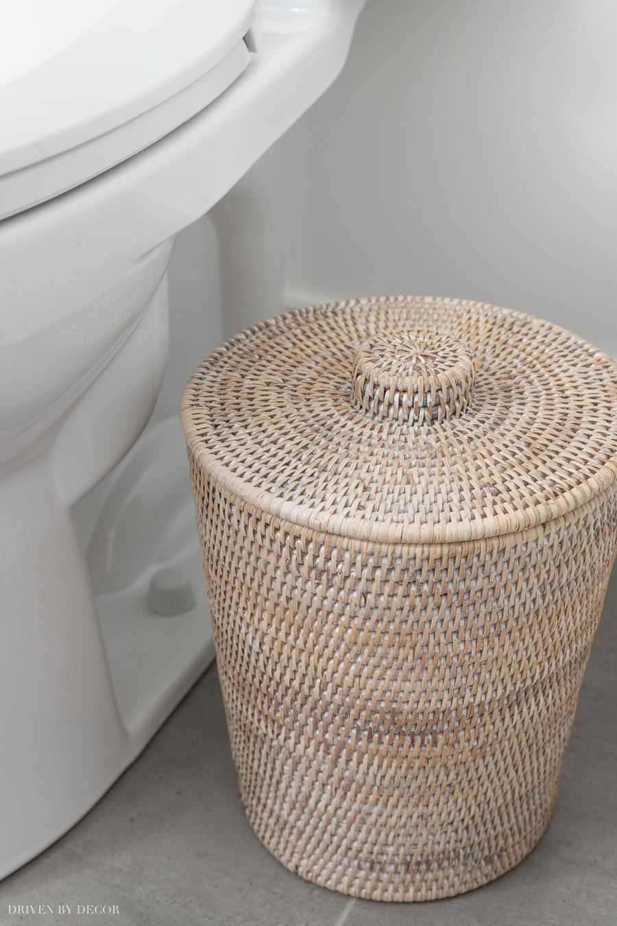 Cute rattan trash can that comes with a plastic liner inside!