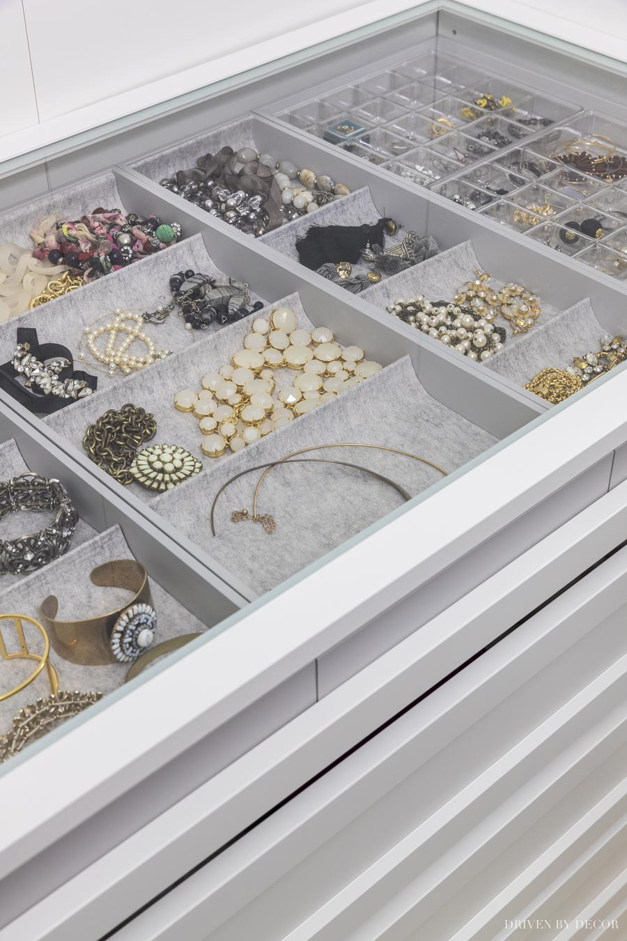 Using a glass shelf above my pull-out jewelry tray in my IKEA PAX closet allows me to see everything at a glance!