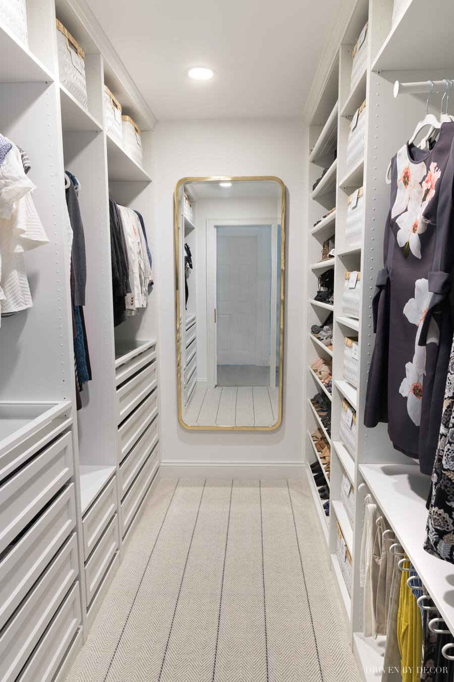 "The layout of our IKEA PAX closet with 22"" deep wardrobes on the left side and 13"" on the right"