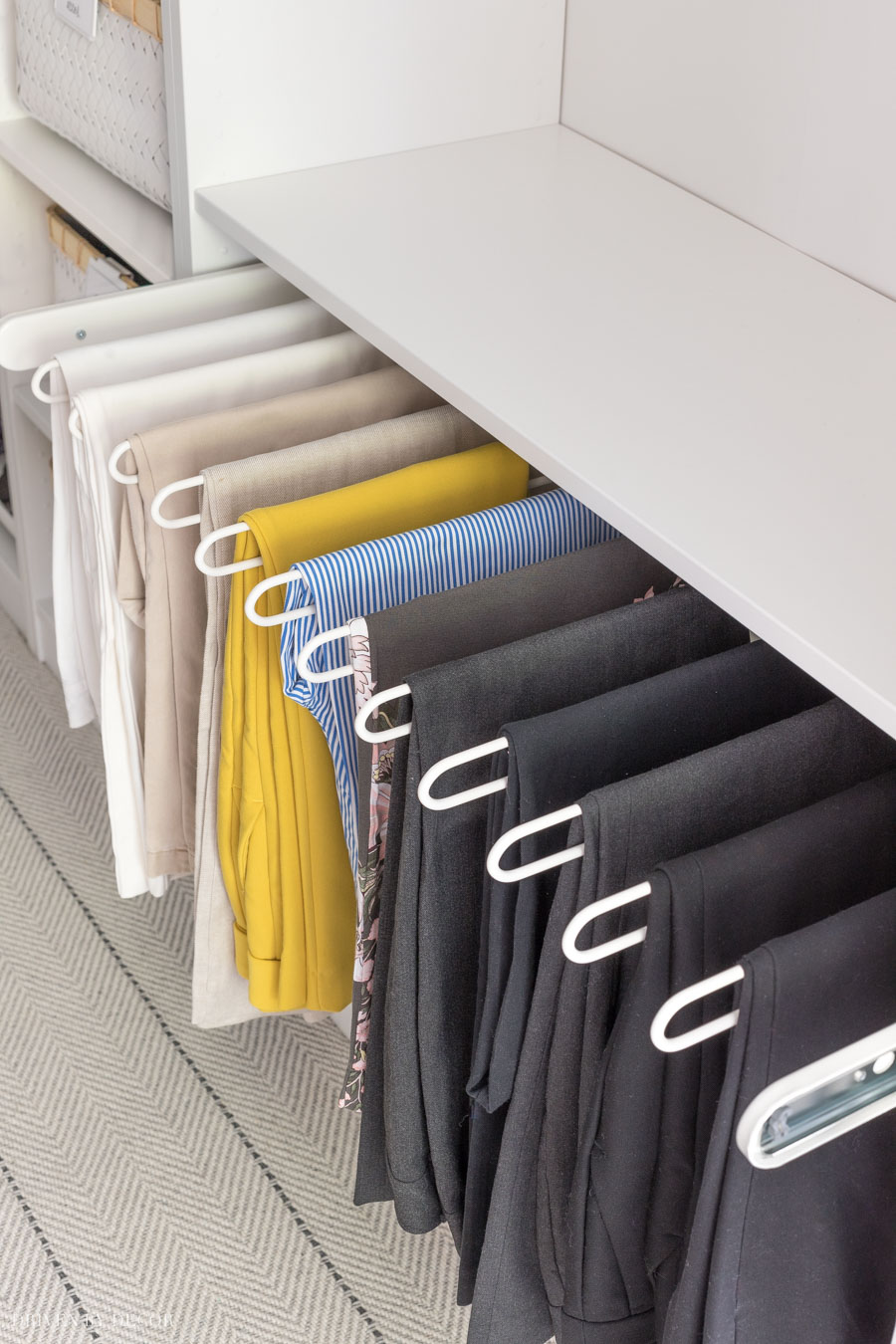 Love having this IKEA PAX KOMPLEMENT pants hanger in our master closet!