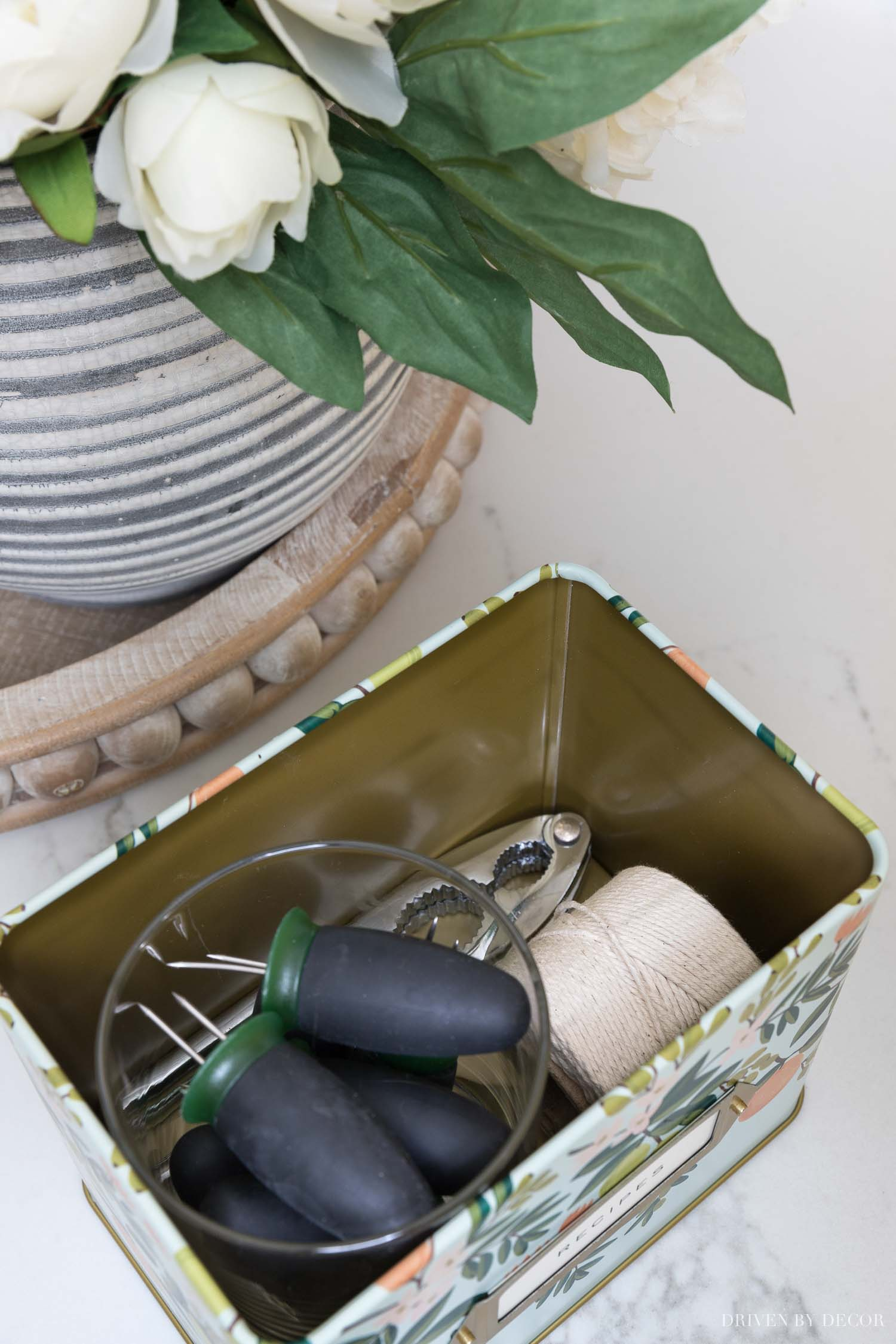 These recipe tins are perfect for hidden storage in the kitchen!
