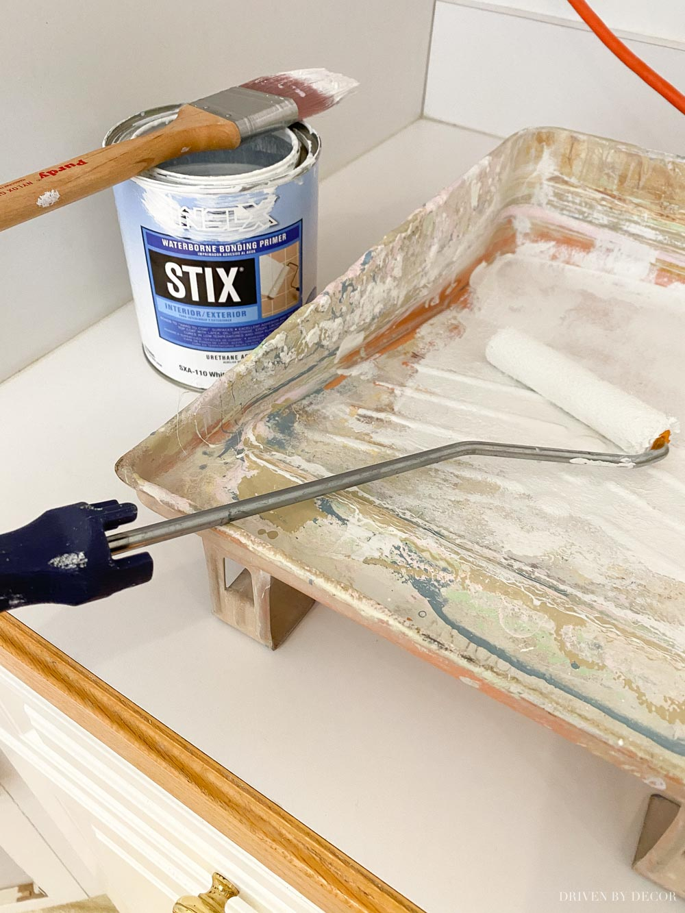 This primer is the BEST for sticking to slick surfaces! We used it on our kitchen cabinet framing!