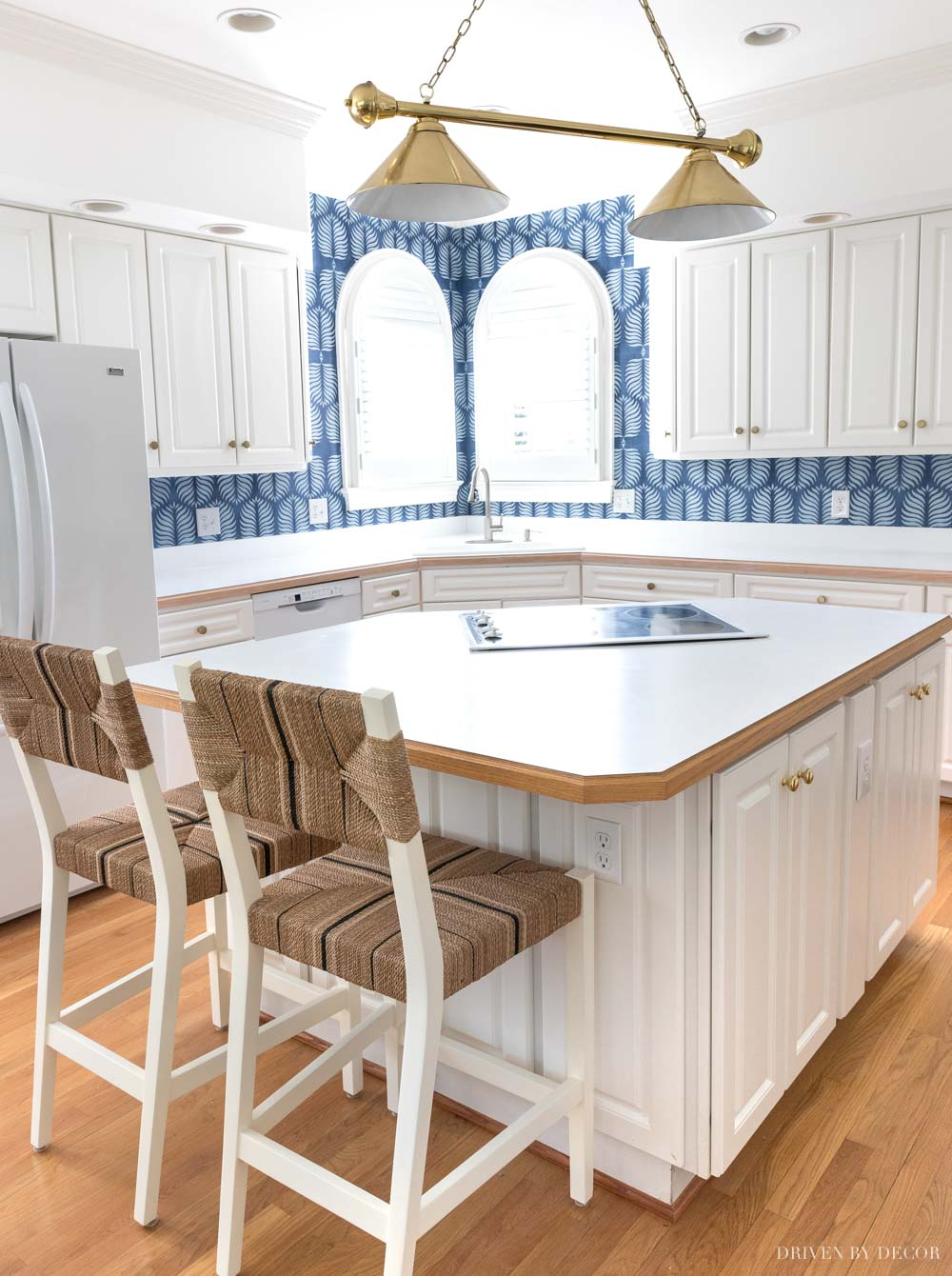 A wallpaper backsplash as an inexpensive way to update our dated kitchen!