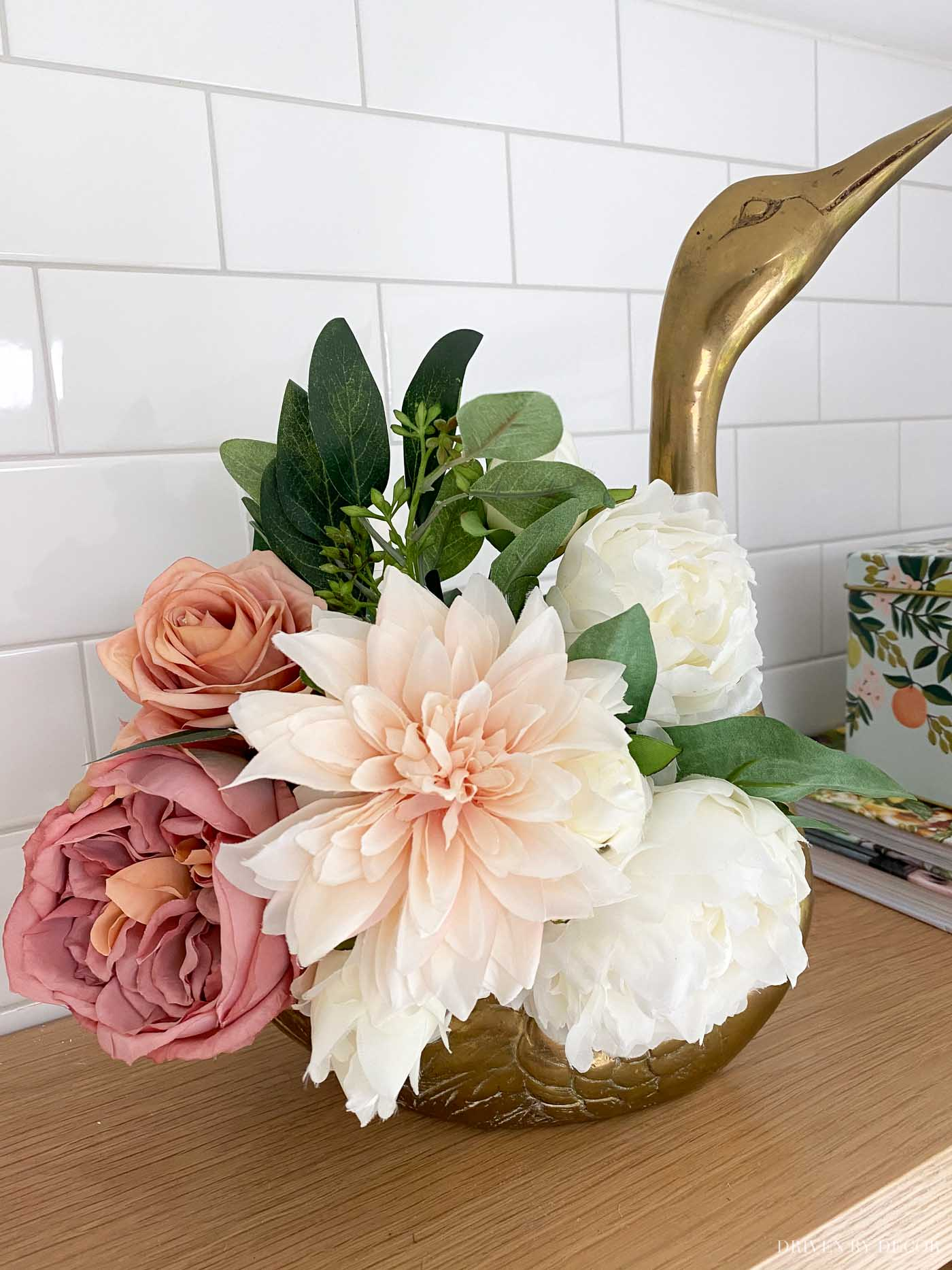 Faux fall florals filling this beautiful swan planter as part of our kitchen fall decor!