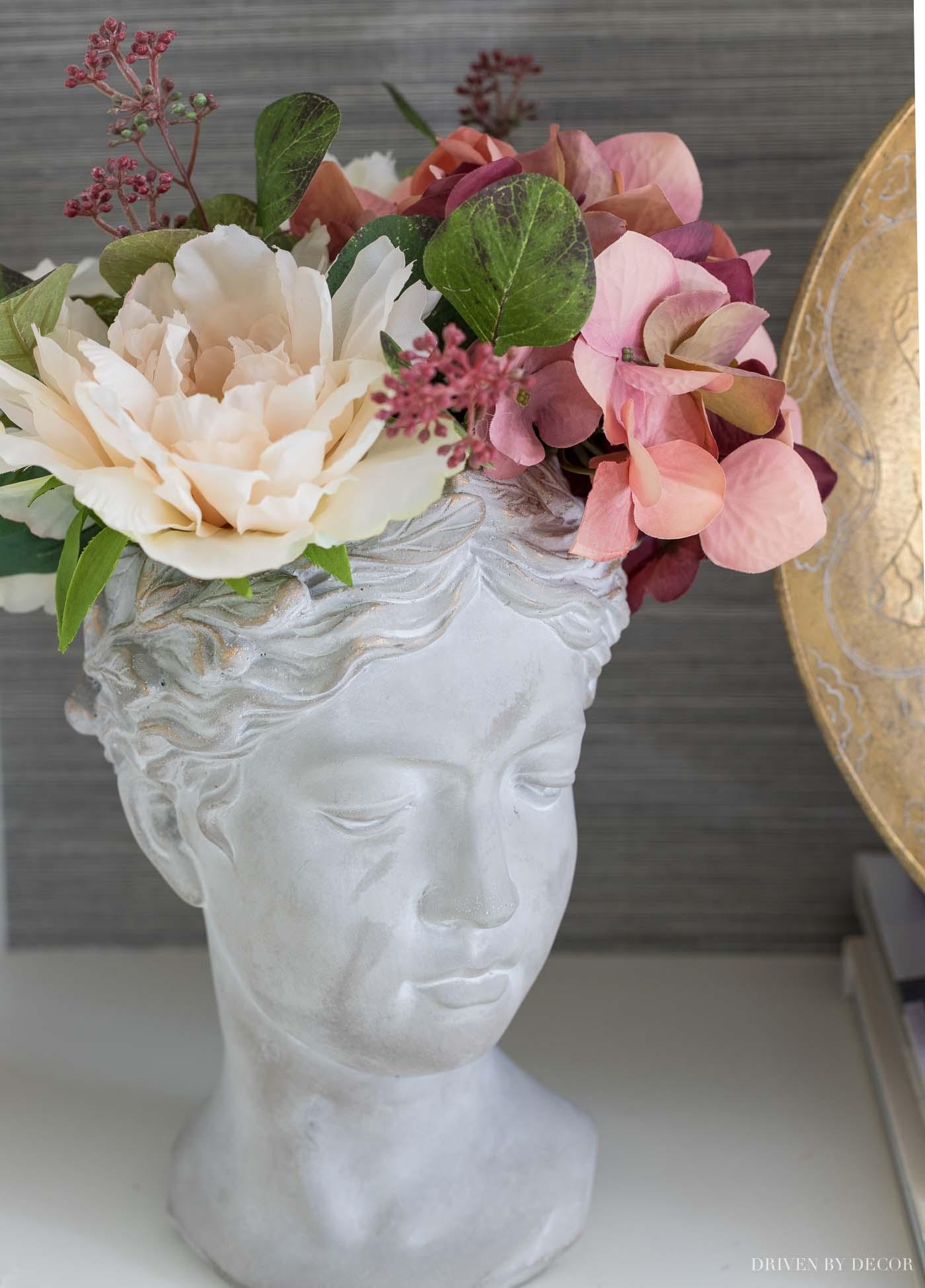 Faux fall flowers in the prettiest bust planter!
