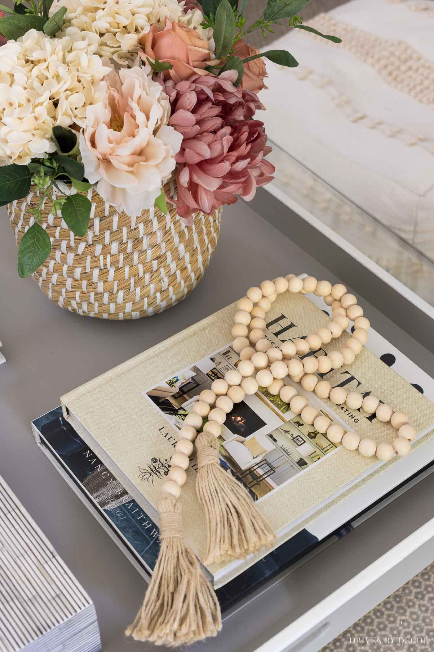 Strand of wood beads with tassels as the perfect fall decor for your coffee table!