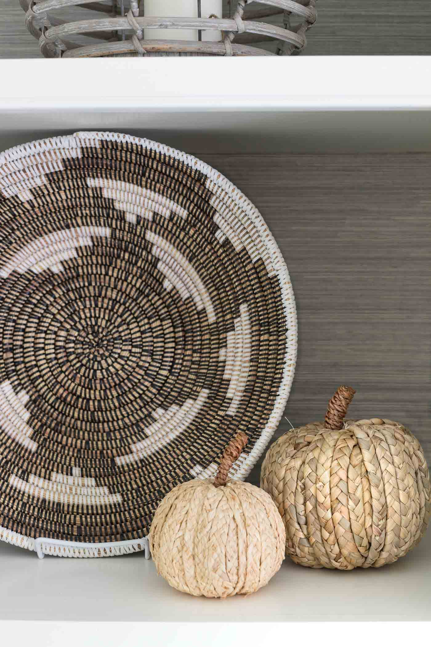 Cute woven pumpkins make the perfect fall decor for shelves and bookcases!