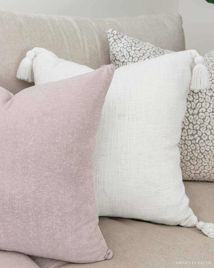 Love this trio of fall pillows - blush herringbone (in cozy flannel), cream tassel, and neutral leopard pillows!