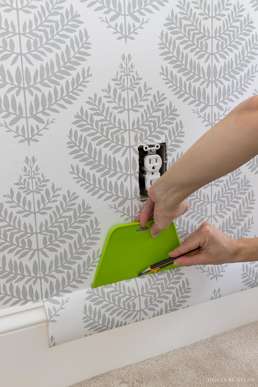 Tips for cutting off extra wallpaper in a perfect straight line!