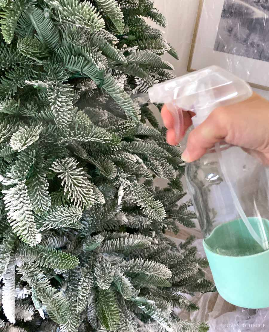 How to flock a Christmas tree - spraying to set the flocking powder is the last step!