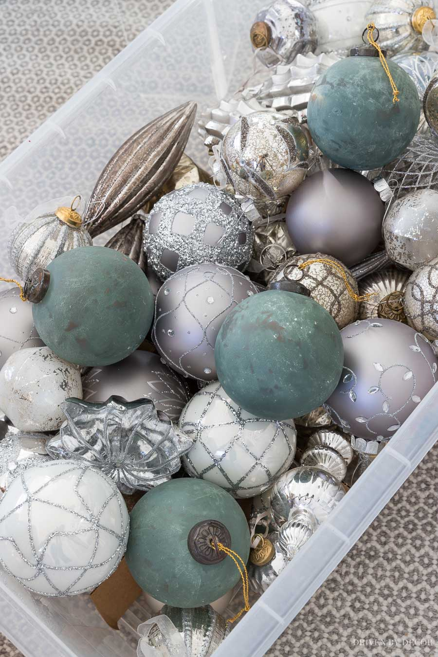Love this mix of gold, silver, and green ornaments for decorating a Christmas tree!