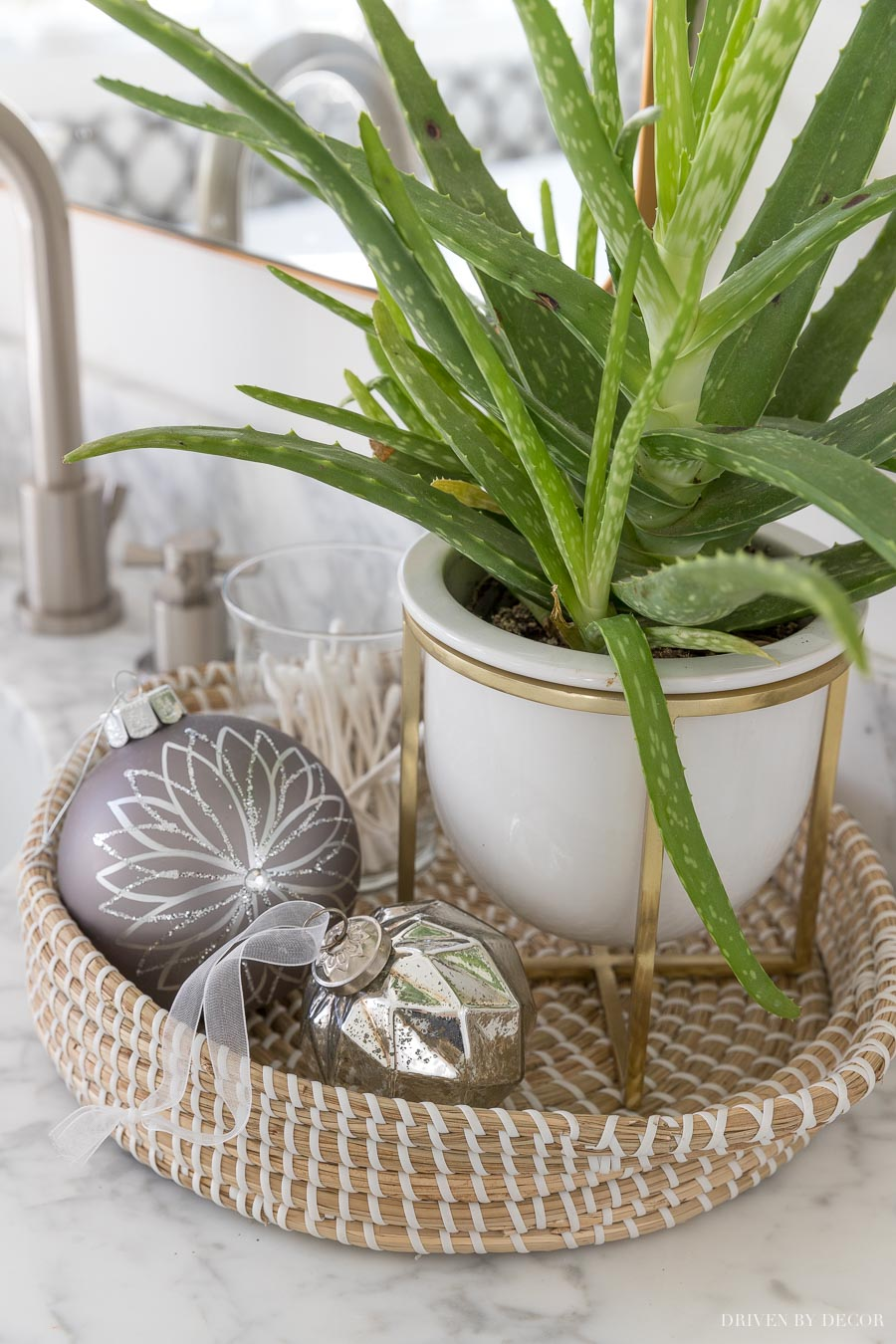 Love this seagrass basket in her bathroom - perfect for between the sinks!