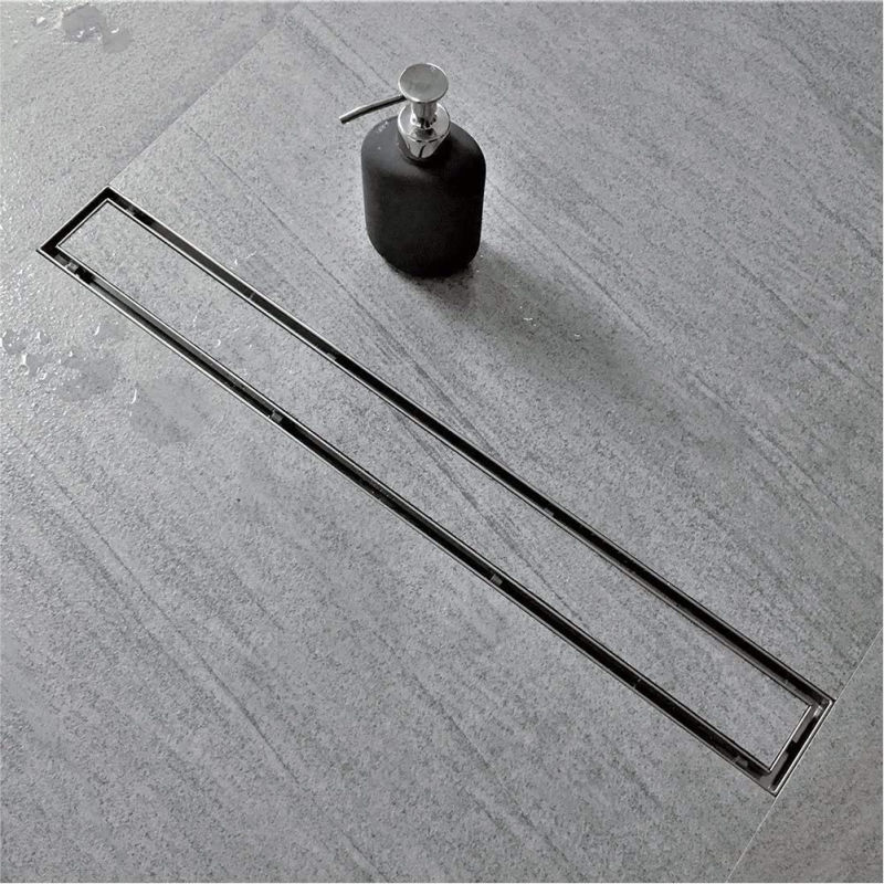 Linear shower drain that you can inset your shower tile into for a seamless look - love!