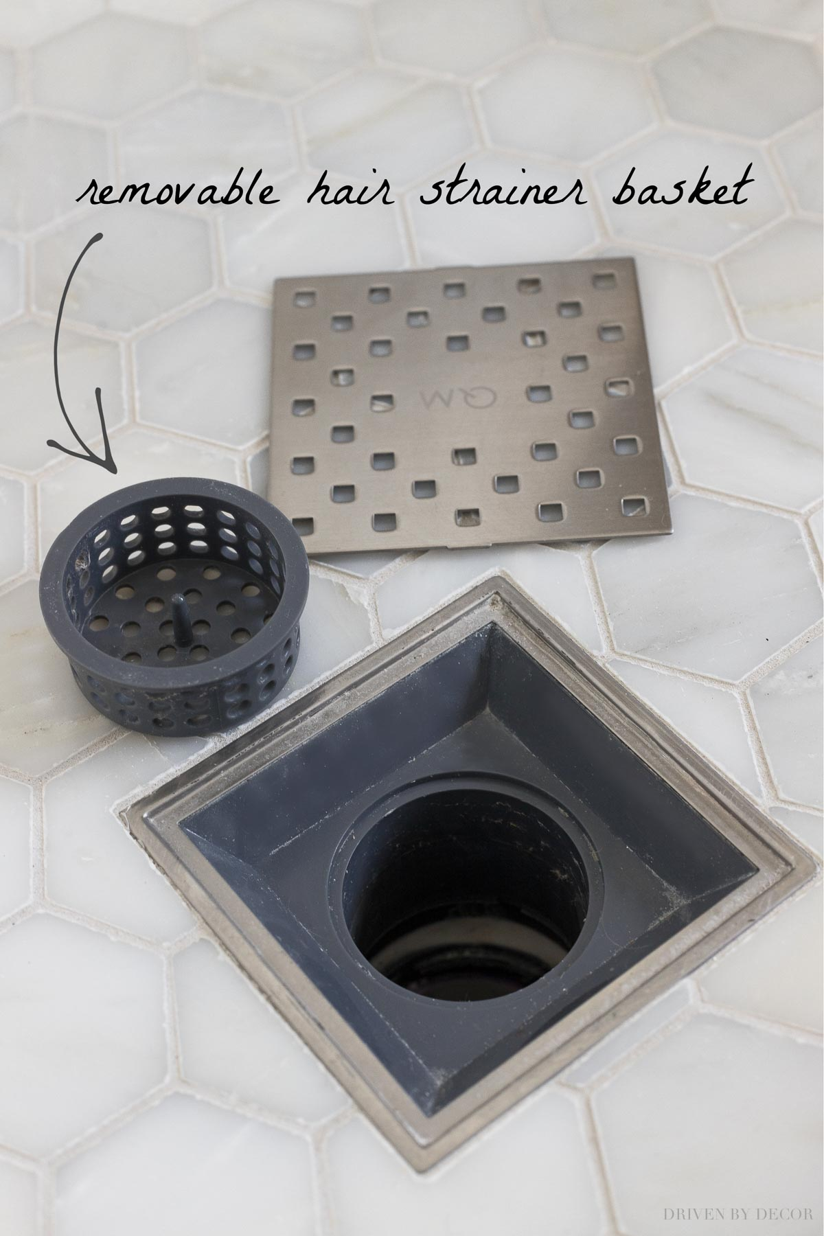 This shower drain has a removable hair strainer basket - such a smart master bathroom remodel idea!