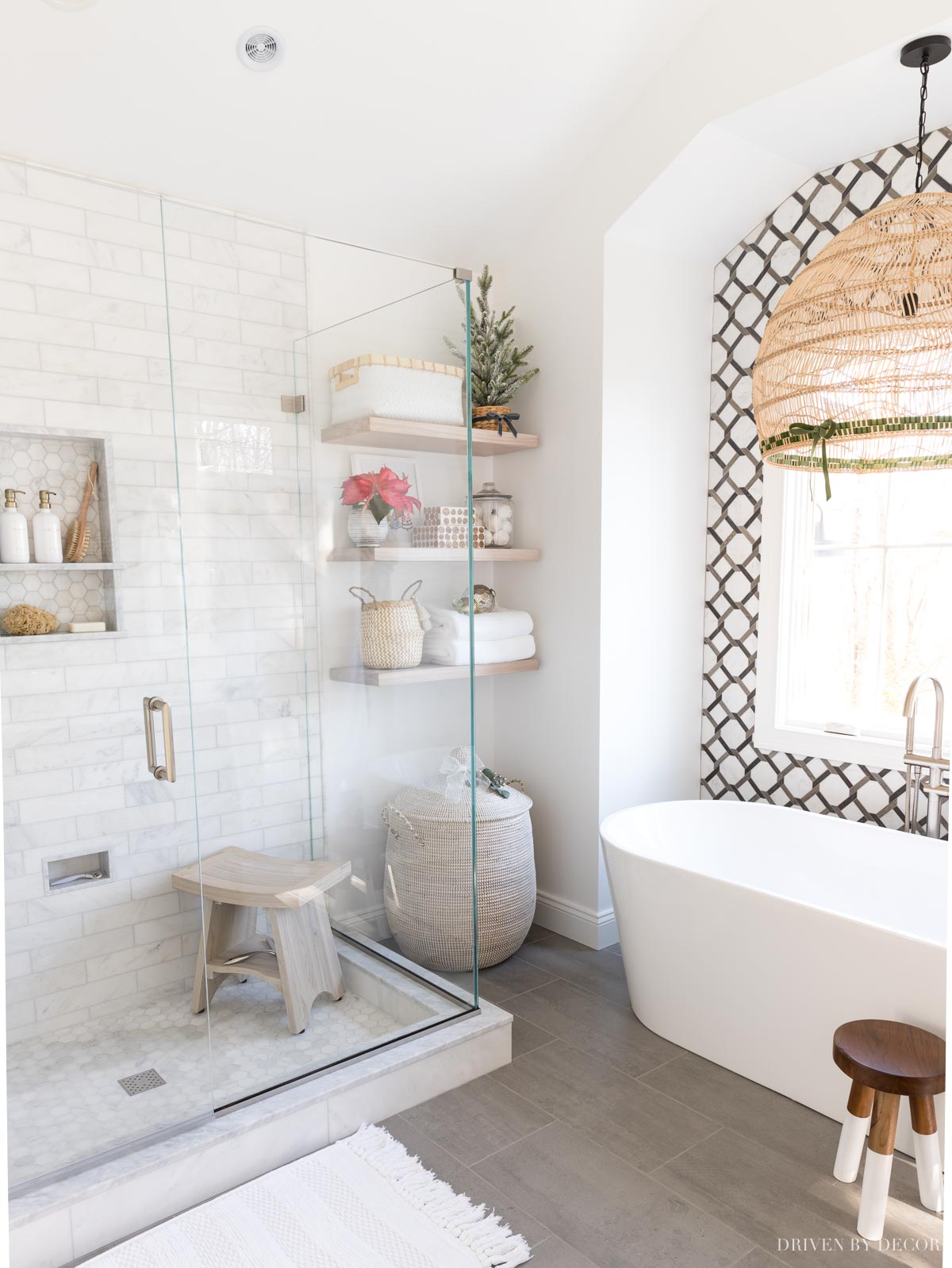 Love that gorgeous tile on the wall in this master bathroom! Great master bathroom remodel idea!