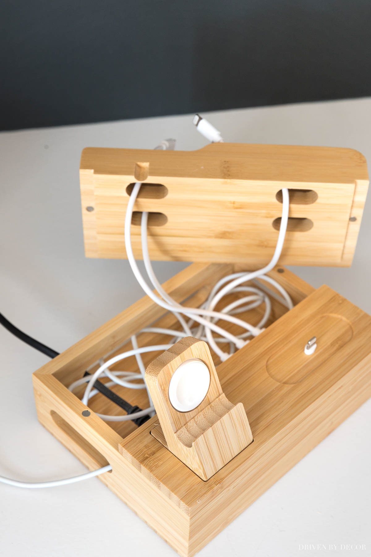 This small charging station is awesome for hiding the mess of charging cords inside!