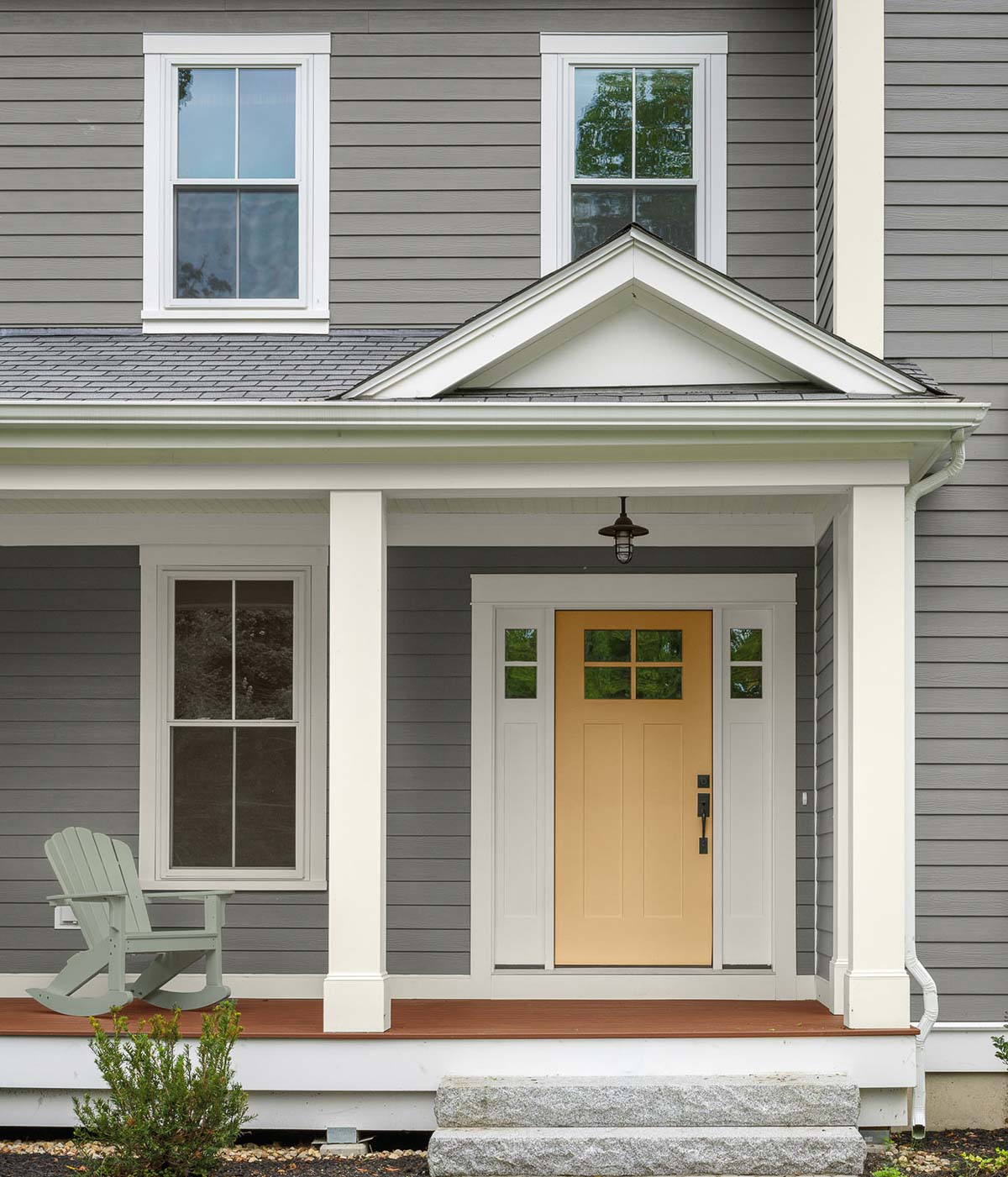 Several of Behr's paint colors of the year are on this home - love the siding and door colors!