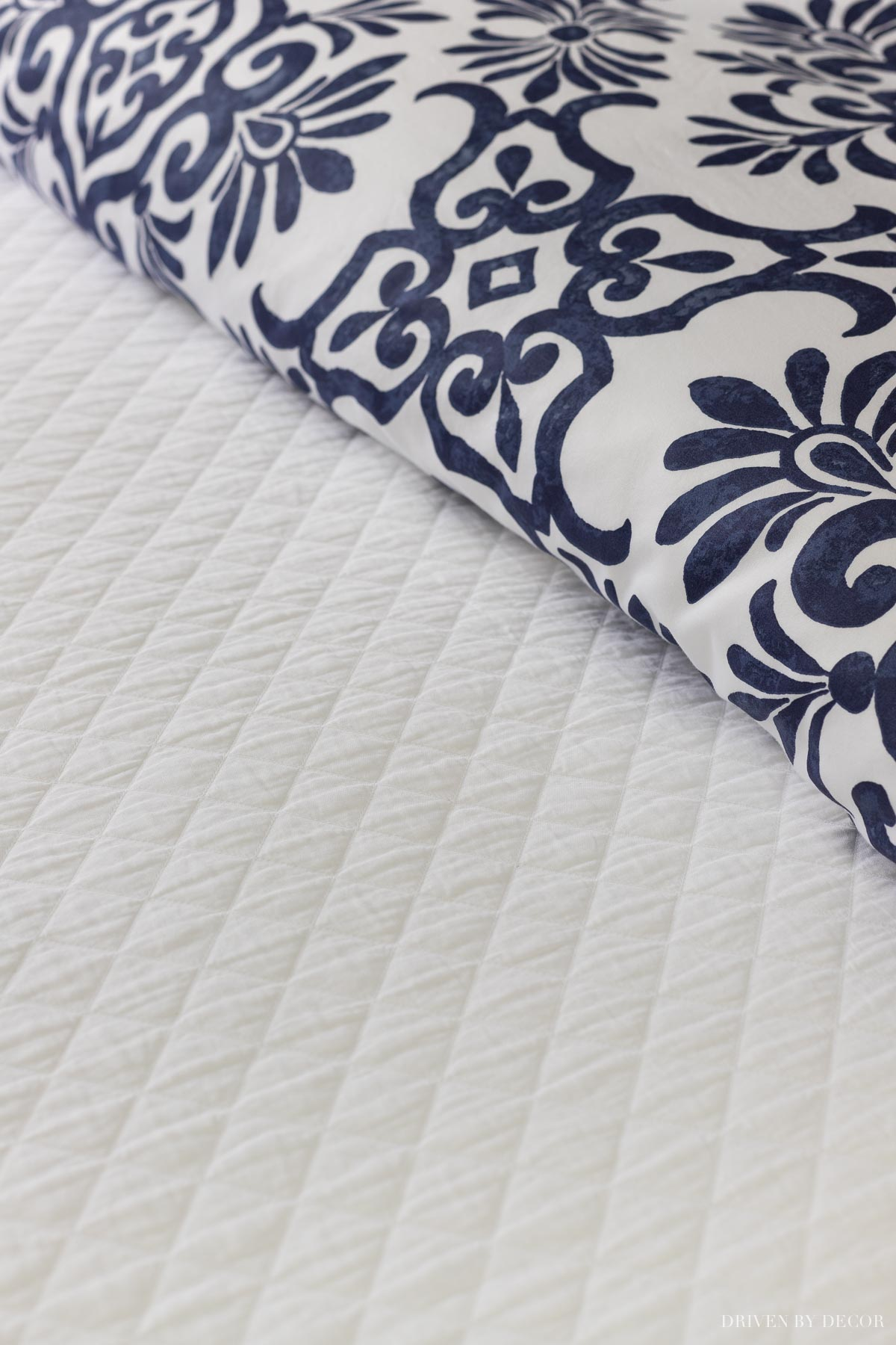 Love this white coverlet - one of my favorite bedding essentials!
