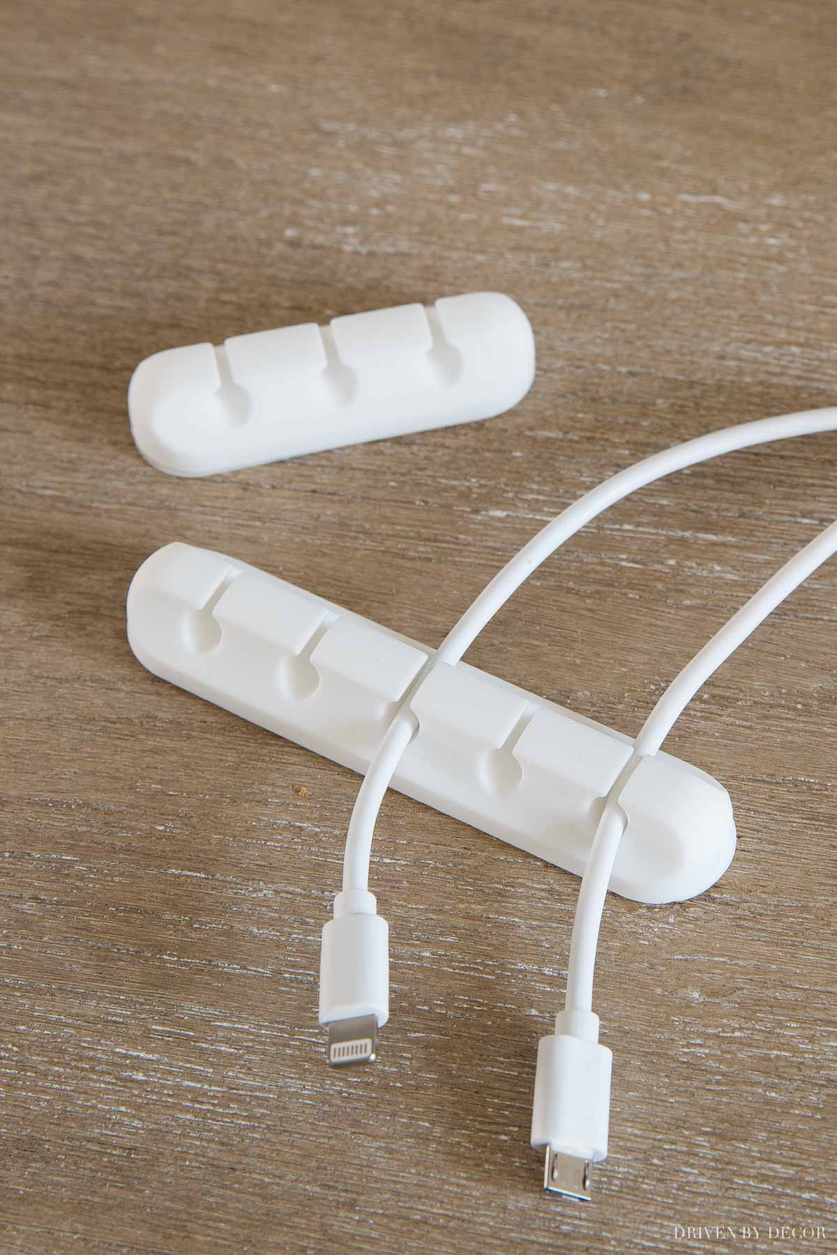 These adhesive cord holders are awesome for keeping cords from slipping behind your desk!