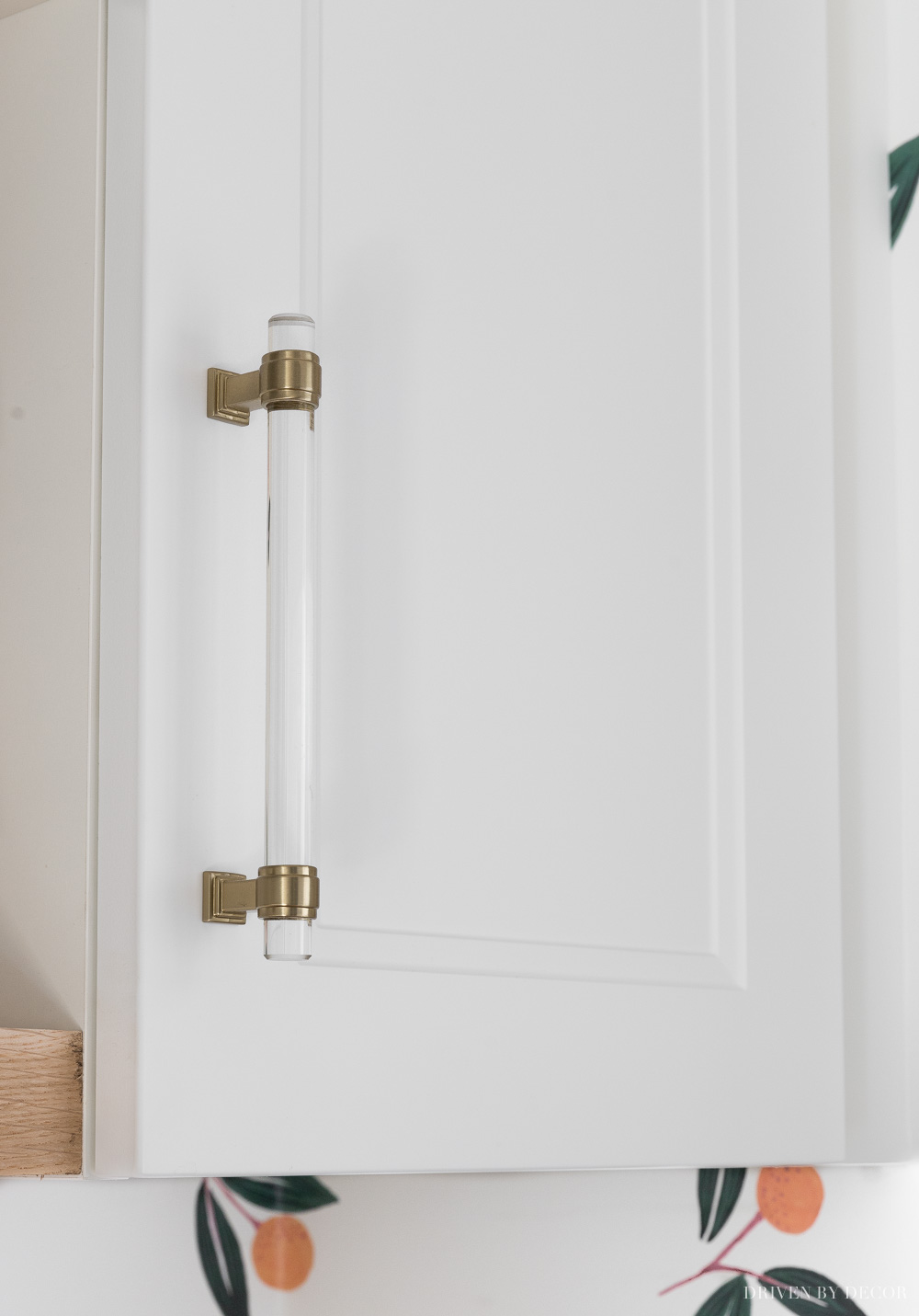 LOVE these acrylic cabinet pulls that totally dress up my Ikea laundry room cabinets!