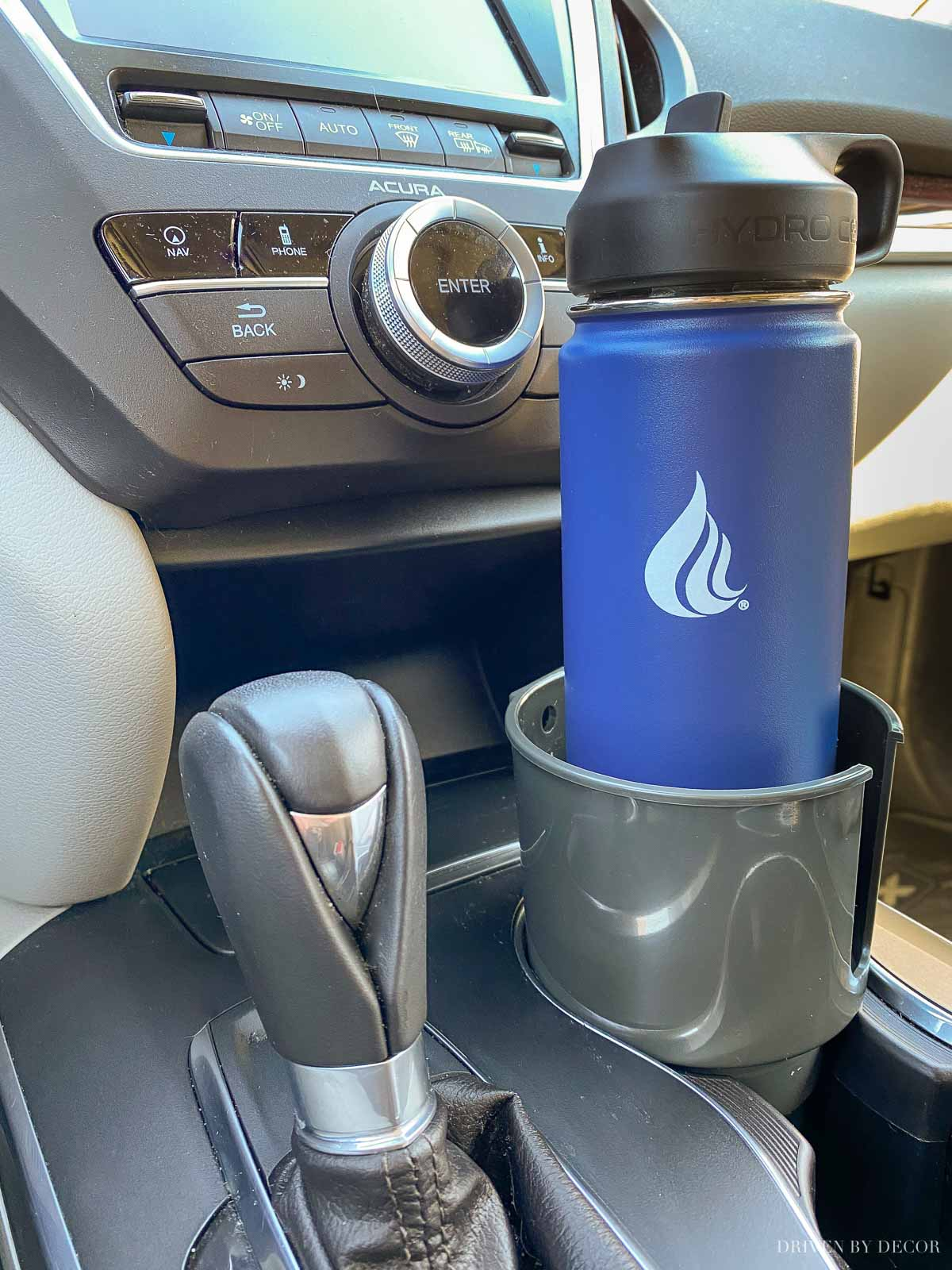 Love this car cup holder that fits large water bottles and mugs with handles too!