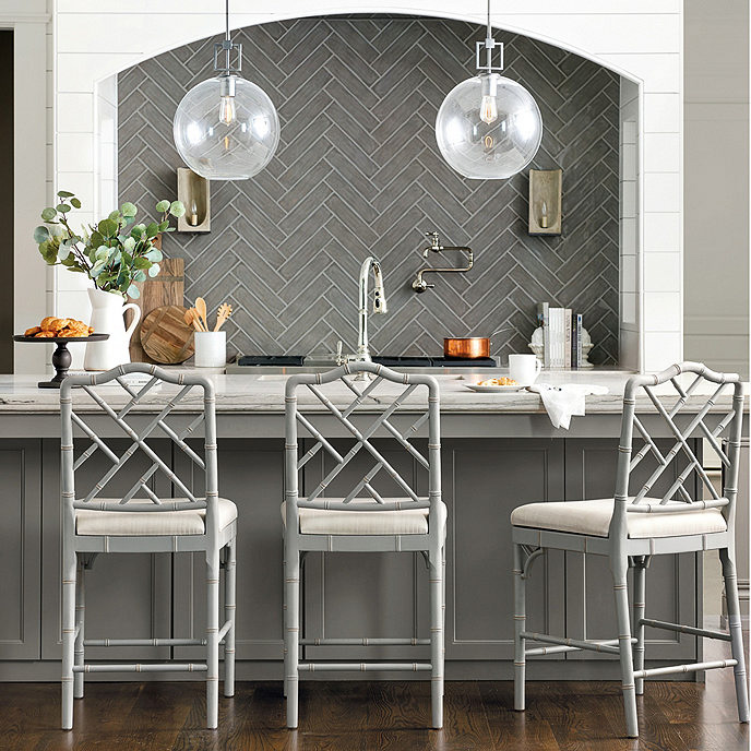 Love the gorgeous Chippendale design on the chair backs of these counter stools!