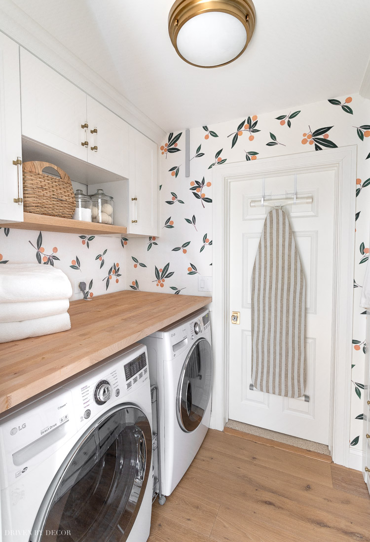Our Ikea laundry room! I share all of the details of our Ikea cabinets, wood countertop, wardrobes, & more in this post!
