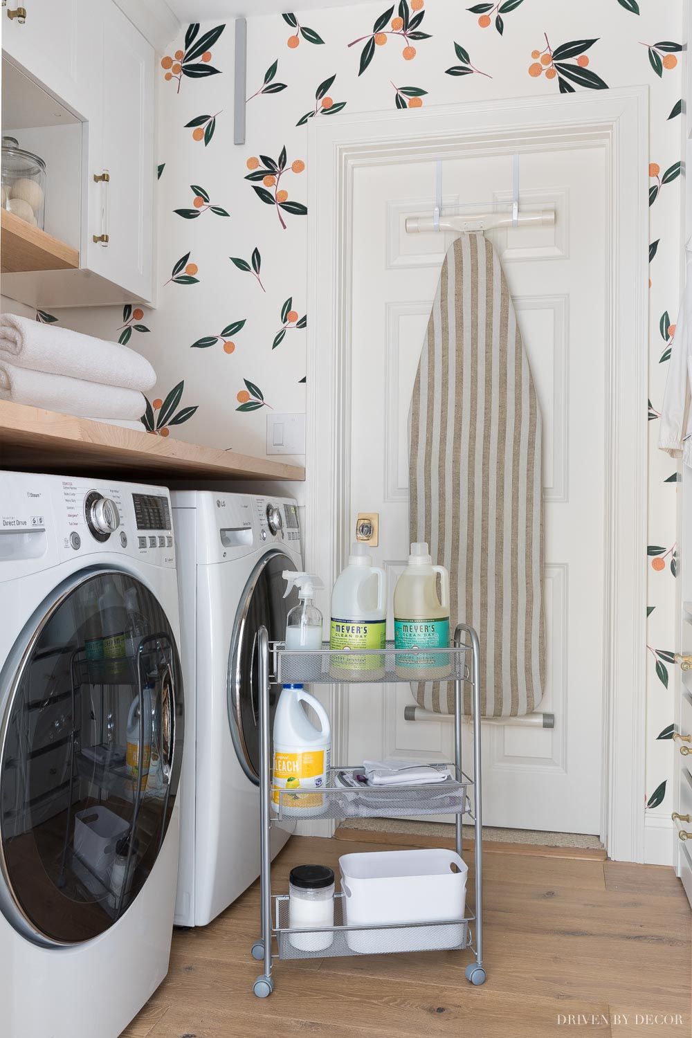 This slim rolling cart between our washer and dryer is the perfect storage solution for my most used laundry products!